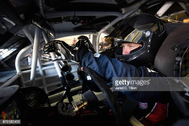 Matt Kenseth driver of the XFINITY Team USA Toyota adjusts his gloves as he sits in his car during practice for the Monster Energy NASCAR Cup Series...