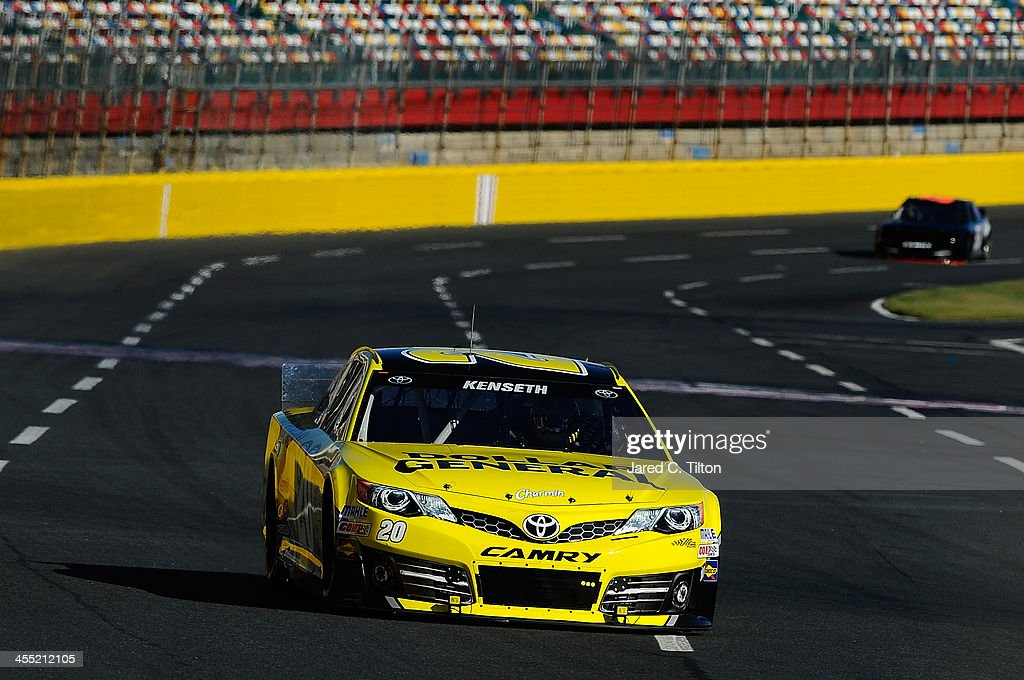 Matt Kenseth drives the #20 Dollar General Toyota during testing at Charlotte Motor Speedway on December 11, 2013 in Charlotte, North Carolina.