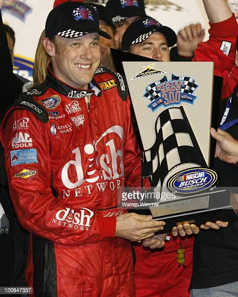 Matt Kenseth holding the winners trophy after winning the Stater Brothers 300 NASCAR BUSCH SERIES being run at California Speedway Fontana Ca Feb 24...