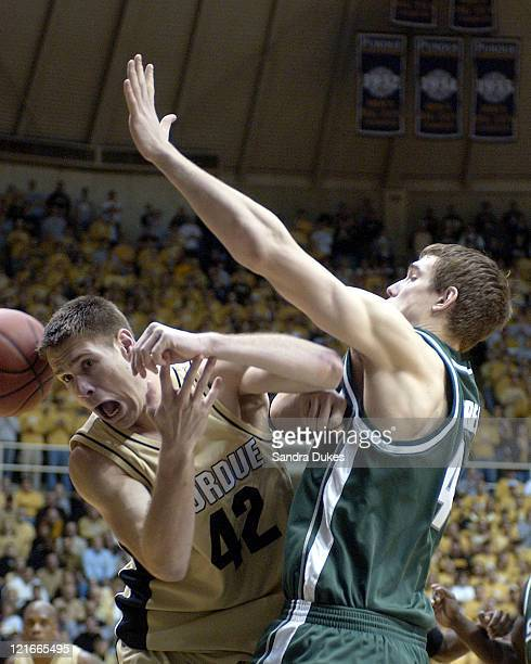 Matt Kiefer is fouled by Jason Andreas in the second half of Purdue's 76-70 win.