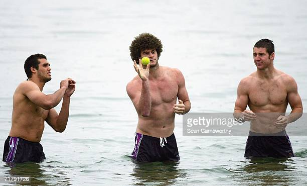 Matt King of the Storm catches a tennis ball watched by teammates during a Melbourne Storm recovery session at St Kilda Beach on September 6 2006 in...