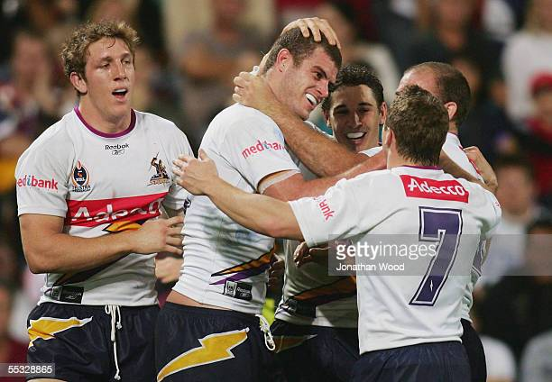 Matt King of the Storm is congratulated by team mates after scoring a try during the NRL qualifying final between the Brisbane Broncos and Melbourne...