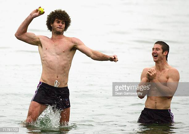 Matt King of the Storm throws a tennis ball during a Melbourne Storm recovery session at St Kilda Beach on September 6 2006 in Melbourne Australia...