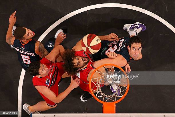 Matt Knight of the Wildcats and Matt Burston of the Taipans contest a rebound during game two of the NBL Finals series between the Perth Wildcats and...
