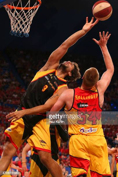 Matt Knight of the Wildcats contests a rebound against Adam Ballinger of the Tigers during the round 19 NBL match between the Perth Wildcats and the...