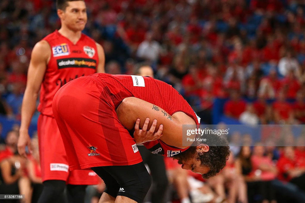 Matt Knight of the Wildcats doubles over in pain after a rebounding contest with Charles Jackson during game one of the NBL Grand FInal series between the Perth Wildcats and the New Zealand Breakers at Perth Arena on March 2, 2016 in Perth, Australia.