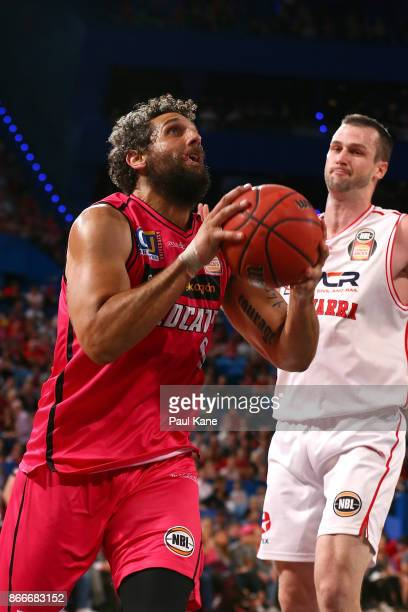 Matt Knight of the Wildcats drives to the basket during the round four NBL match between the Perth Wildcats and the Illawarra Hawks at Perth Arena on...