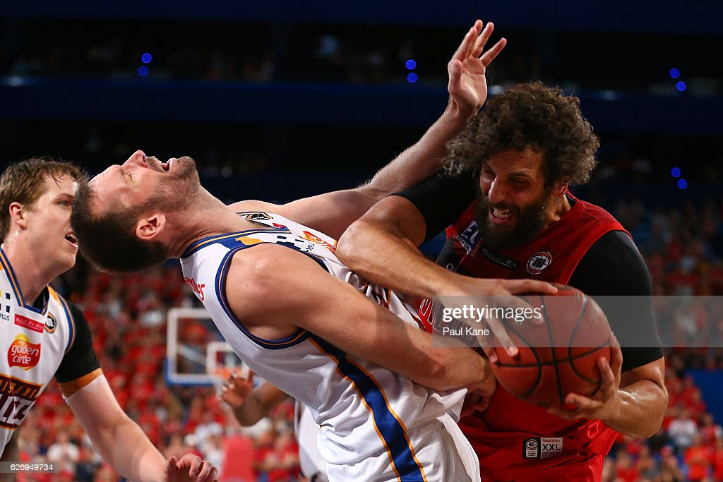 Matt Knight of the Wildcats gets fouled by Anthony Petrie of the Bullets during the round nine NBL match between the Perth Wildcats and the Brisbane Bullets at Perth Arena on December 1, 2016 in Perth, Australia.
