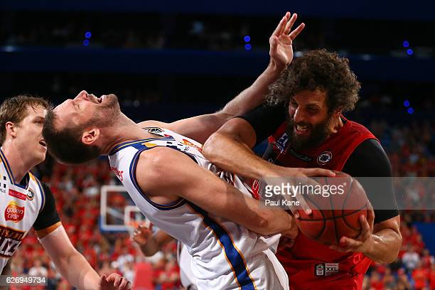 Matt Knight of the Wildcats gets fouled by Anthony Petrie of the Bullets during the round nine NBL match between the Perth Wildcats and the Brisbane...