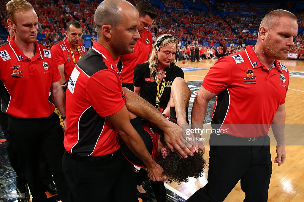 Matt Knight of the Wildcats is taken from the court on a stretcher after taking a charge from Cam Bairstow of the Bullets during the round nine NBL match between the Perth Wildcats and the Brisbane Bullets at Perth Arena on December 1, 2016 in Perth, Australia.