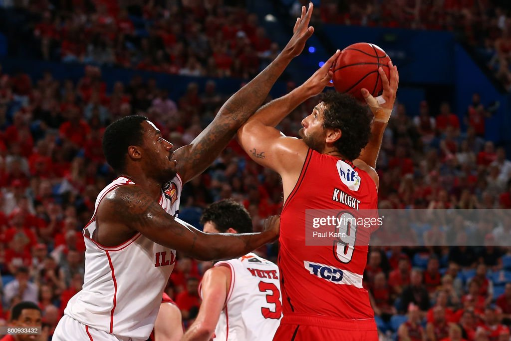 Matt Knight of the Wildcats looks to put a shot up against Delvon Johnson of the Hawks during the round two NBL match between the Perth Wildcats and the Illawarra Hawks at Perth Arena on October 13, 2017 in Perth, Australia.