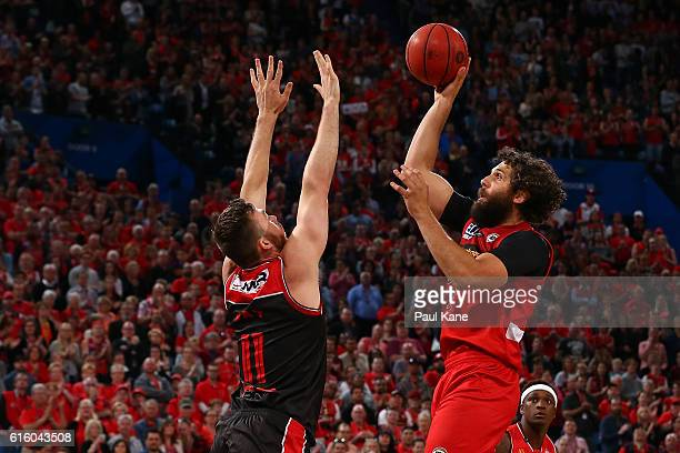Matt Knight of the Wildcats puts a shot up against Nick Kay of the Hawks during the round three NBL match between the Perth Wildcats and the...