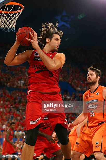 Matt Knight of the Wildcats rebounds during the round seven NBL match between the Perth Wildcats and the Cairns Taipans at Perth Arena on November 22...