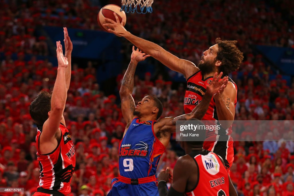 Matt Knight of the Wildcats rejects a shot by Gary Ervin of the 36ers during game one of the NBL Grand Final series between the Perth Wildcats and the Adelaide 36ers at Perth Arena on April 7, 2014 in Perth, Australia.