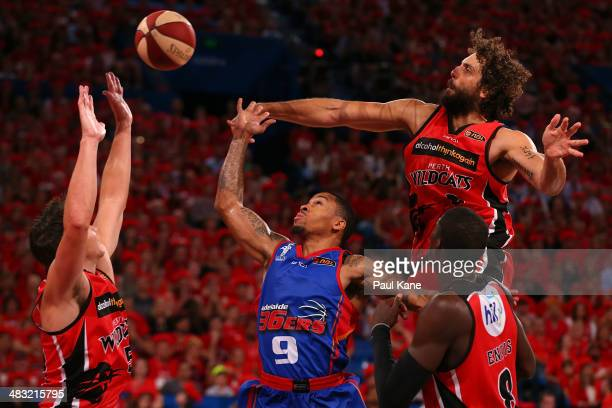 Matt Knight of the Wildcats rejects a shot by Gary Ervin of the 36ers during game one of the NBL Grand Final series between the Perth Wildcats and...