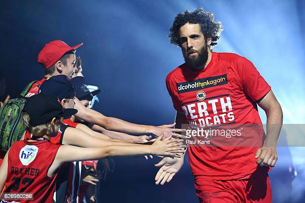 Matt Knight of the Wildcats runs onto the court as players are introduced during the round nine NBL match between the Perth Wildcats and the Brisbane...