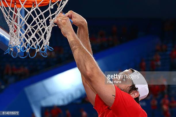 Matt Knight of the Wildcats snips the net after winning the Championship during game three of the NBL Grand Final series between the Perth Wildcats...