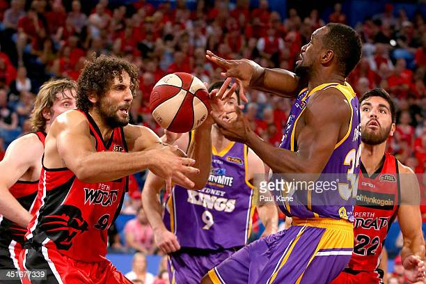 Matt Knight of the Wildcats strips the ball from Sam Young of the Kings during the round seven NBL match between the Perth Wildcats and the Sydney...