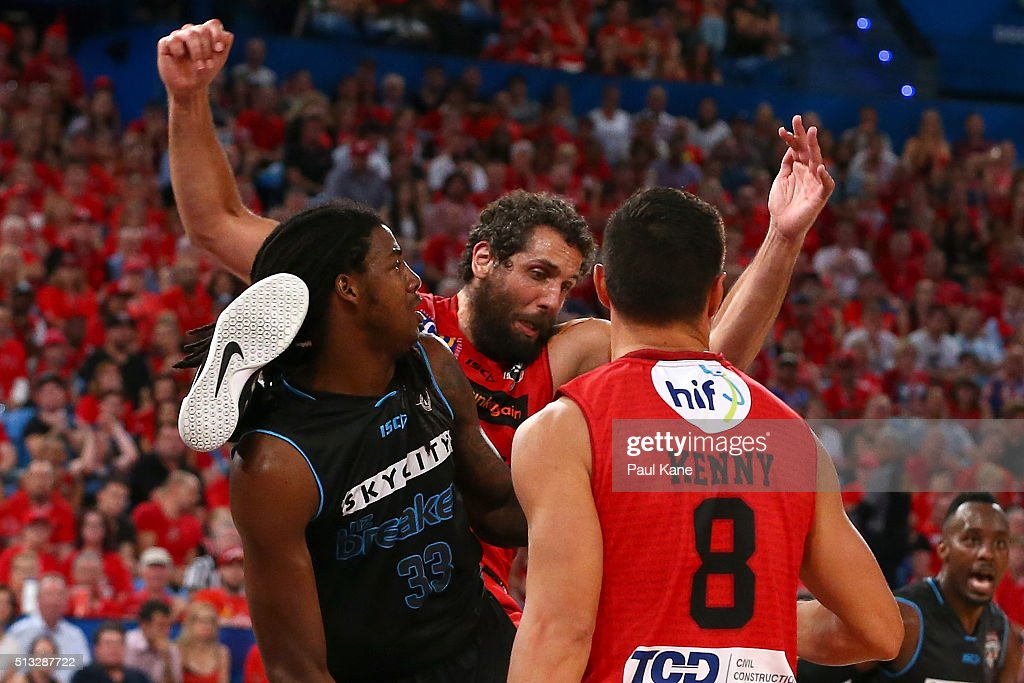 Matt Knight of the Wildcats tangles with Charles Jackson of the Breakers while rebounding during game one of the NBL Grand FInal series between the Perth Wildcats and the New Zealand Breakers at Perth Arena on March 2, 2016 in Perth, Australia.