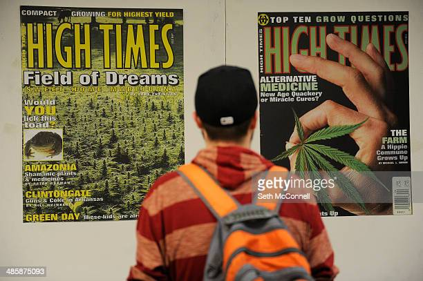 Matt Knorr of Rochester New York checks out the display of High Times magazine covers during the High Times Cannabis Cup at Denver Mart in Denver...