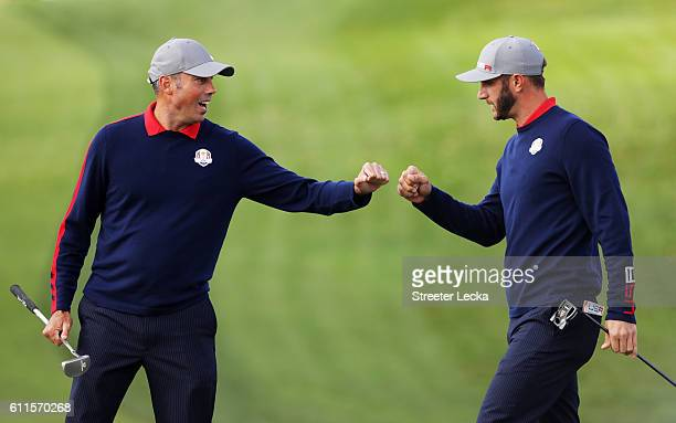 Matt Kuchar and Dustin Johnson of the United States react on the tenth green during morning foursome matches of the 2016 Ryder Cup at Hazeltine...