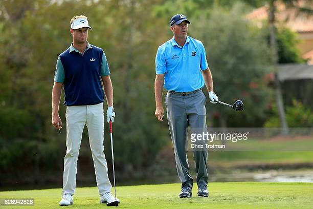 Matt Kuchar and his teammate Harris English watch his tee shot on the fourth hole during the final round of the Franklin Templeton Shootout at...