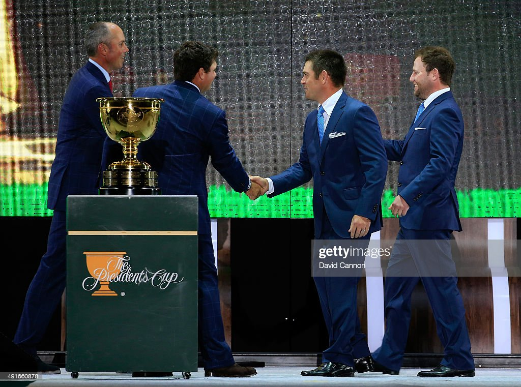 Matt Kuchar and Patrick Reed of the United States (l) shake hands with the International team opponents Louis Oosthuizen and Branden Grace of South Africa and the International team during the opening ceremony of the 2015 Presidents Cup at the Convensia Ceremony Hall on October 7, 2015 in Incheon City, South Korea.
