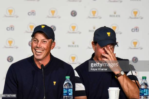 Matt Kuchar and Phil Mickelson of the US Team laugh during a press conference following the team's victory after Sunday Singles matches at the...