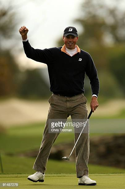 Matt Kuchar celebrates a birdie on the 18th hole during a play-off against Vaughn Taylor at the 2009 Turning Stone Resort Championship at Atunyote...