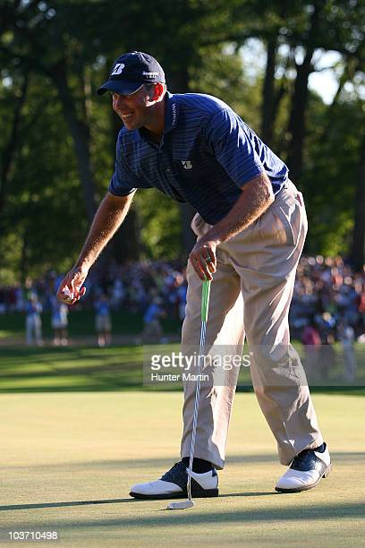 Matt Kuchar celebrates after he made his putt on the 18th green during a 1 hole playoff to win The Barclays at the Ridgewood Country Club on August...