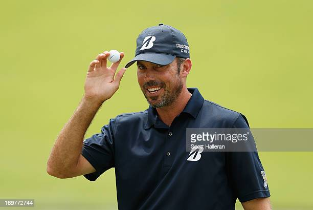 Matt Kuchar celebrates his birdie putt on the 13th hole during the third round of the Memorial Tournament presented by Nationwide Insurance at...
