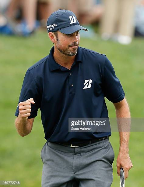Matt Kuchar celebrates his birdie putt on the 14th hole during the third round of the Memorial Tournament presented by Nationwide Insurance at...