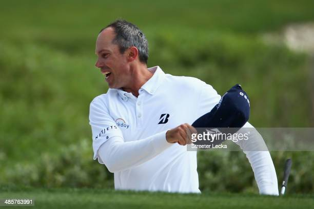 Matt Kuchar celebrates on the 18th green during the final round of the RBC Heritage at Harbour Town Golf Links on April 20, 2014 in Hilton Head...