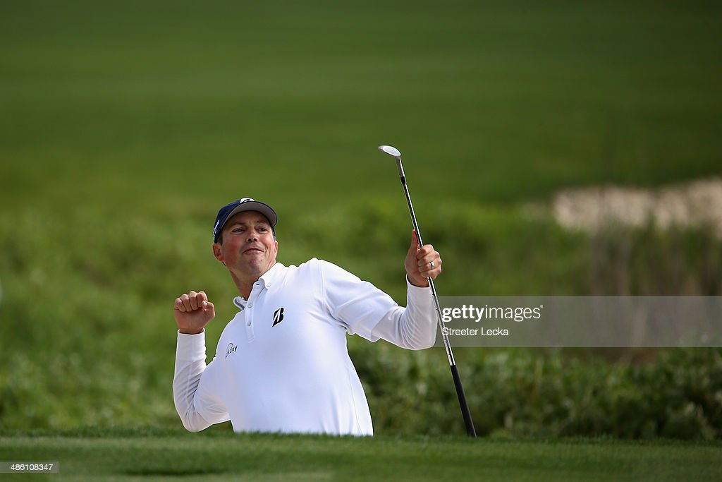 Matt Kuchar celebrates on the 18th green during the final round of the RBC Heritage at Harbour Town Golf Links on April 20, 2014 in Hilton Head Island, South Carolina.