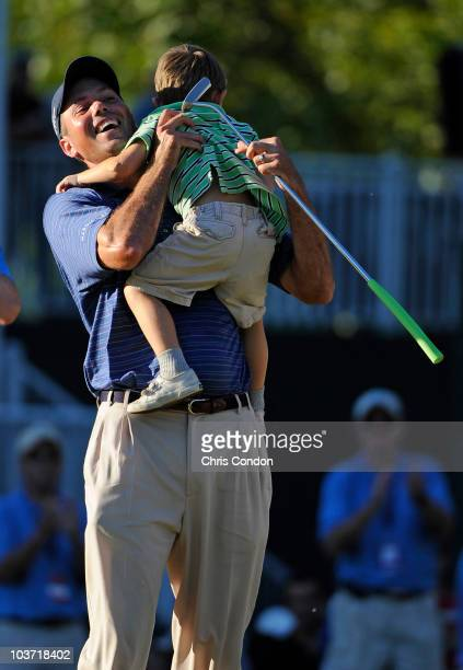 Matt Kuchar celebrates with his son Cameron after winning The Barclays at Ridgewood Country Club on August 29 2010 in Paramus New Jersey