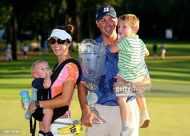 Matt Kuchar celebrates with his wife Sybi and sons Cameron and Carson after he made his putt on the 18th green during a 1 hole playoff to win The...