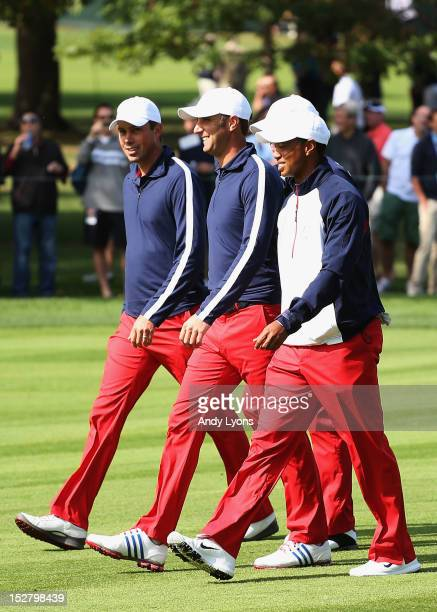 Matt Kuchar Dustin Johnson Steve Stricker and Tiger Woods of the United States walk the course during the third preview day of The 39th Ryder Cup at...