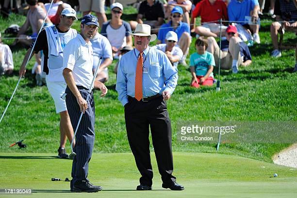 Matt Kuchar gets a ruling on the 8th green from PGA TOUR Rules Official Slugger White during the final round of The Barclays at Liberty National Golf...