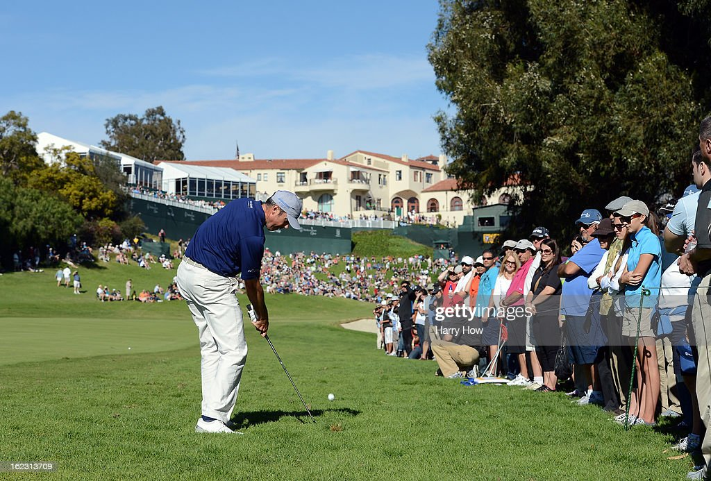 Matt Kuchar hits a second shot on the 18th hole during the third round of the Northern Trust Open at the Riviera Country Club on February 16, 2013 in Pacific Palisades, California.