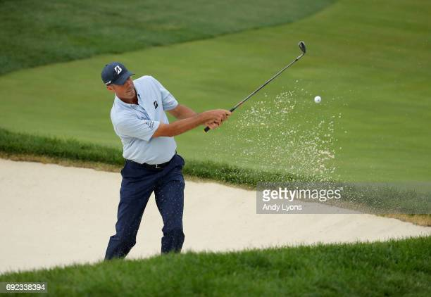 Matt Kuchar hits from a bunker on the 13th hole during the final round of the Memorial Tournament at Muirfield Village Golf Club on June 4 2017 in...