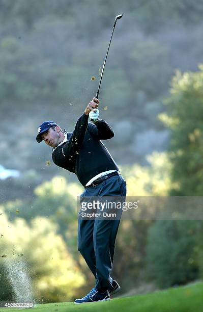 Matt Kuchar hits his second shot on the 18th hole during the first round of the Northwestern Mutual World Challenge at Sherwood Country Club on...