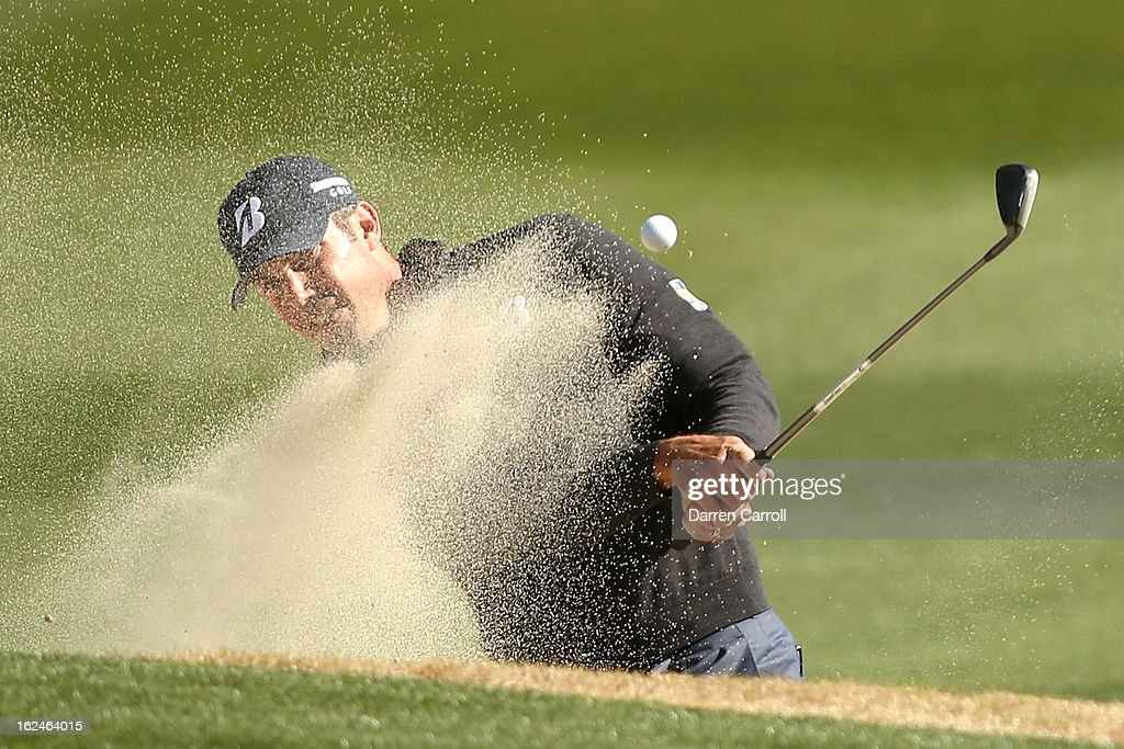 Matt Kuchar hits his third shot on the 11th hole out of the bunker during the quarterfinal round of the World Golf Championships - Accenture Match Play at the Golf Club at Dove Mountain on February 23, 2013 in Marana, Arizona.