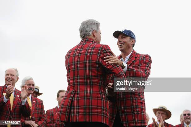 Matt Kuchar is awarded tartan jacket on the 18th green after winning the RBC Heritage at Harbour Town Golf Links on April 20 2014 in Hilton Head...