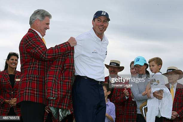 Matt Kuchar is awarded the RBC plaid jacket during the final round of the RBC Heritage at Harbour Town Golf Links on April 20 2014 in Hilton Head...