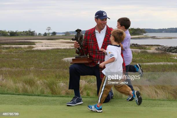 Matt Kuchar is greeted on the 18th green by his sons Carson and Cameron after winning the RBC Heritage at Harbour Town Golf Links on April 20 2014 in...