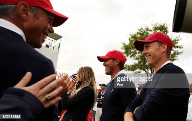 Matt Kuchar Jordan Spieth and Brooks Koepka of the US Team react to a shot by Phil Mickelson of the US Team on the 15th hole during Saturday foursome...