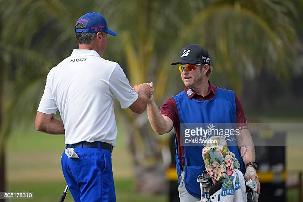 Matt Kuchar makes an eagle on the 9th hole and celebrates with caddie John Wood during the second round of the Sony Open in Hawaii at Waialae Country...