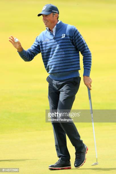 Matt Kuchar of the United States acknowledges the crowd on the 9th green during day two of the AAM Scottish Open at Dundonald Links Golf Course on...