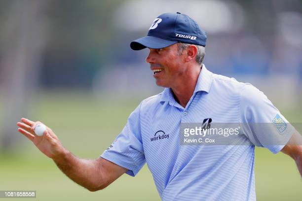 Matt Kuchar of the United States acknowledges the crowd on the first green during the third round of the Sony Open In Hawaii at Waialae Country Club...
