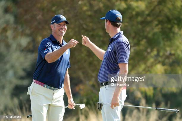 Matt Kuchar of the United States and Harris English of the United States celebrate with a fist bump on the fifth green during the final round of the...